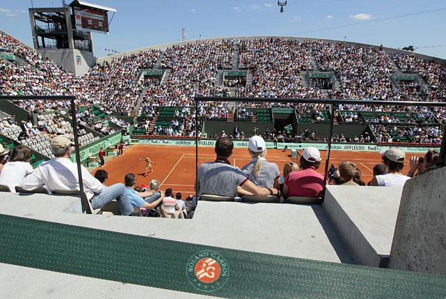 Maria Sharapova returns the ball to Andrea Petkovic at Court Suzanne Lenglen.