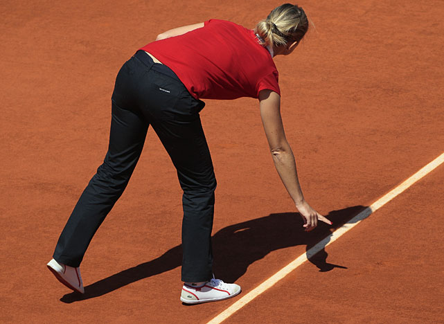 The umpire inspects a line during the Sharapova-Petkovic quarterfinal.