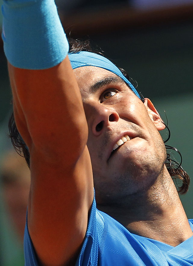 Spain's Rafael Nadal serves to Sweden's Robin Soderling during their quarterfinal match. Nadal won 6-4, 6-1, 7-6(3).