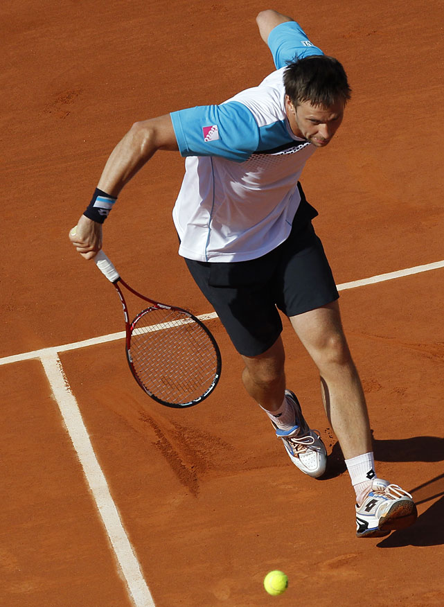 Robin Soderling returns to Rafael Nadal during their quarterfinal.