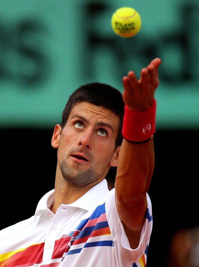 Novak Djokovic serves during Friday's semifinal.