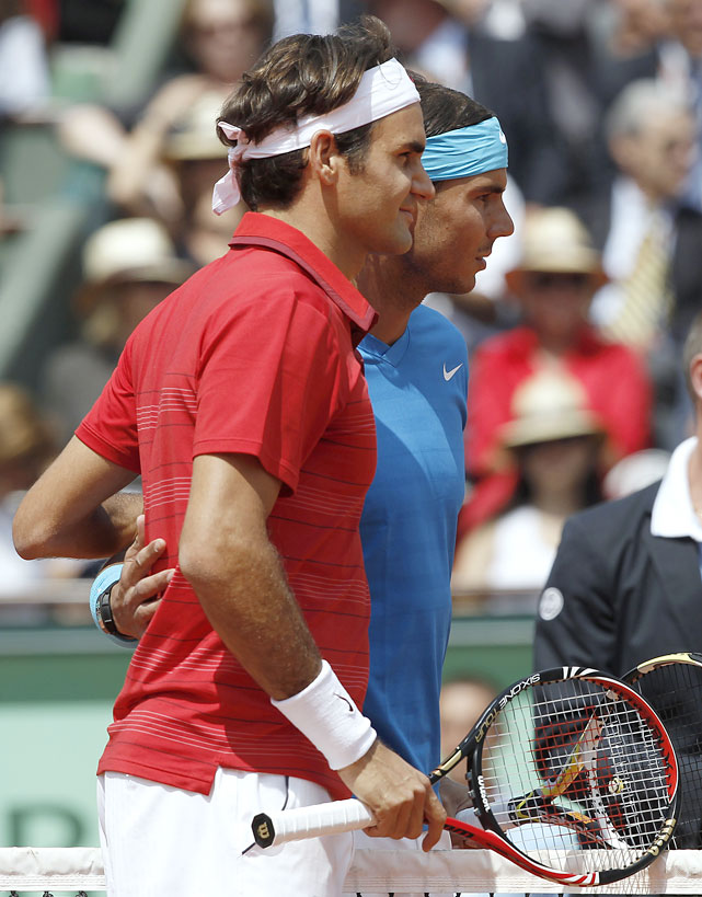 Switzerland's Roger Federer and Spain's Rafael Nadal pose before their French Open men's final on Sunday at Roland Garros. Nadal won 7-5, 7-6(3), 5-7, 6-1.