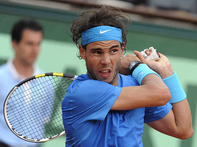 Rafael Nadal hits a return to Roger Federer during Sunday's final.