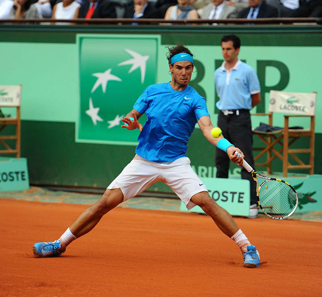 Rafael Nadal plays a return to Roger Federer.