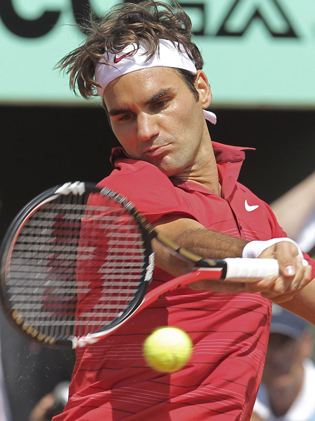 Federer returns to Nadal during Sunday's match.