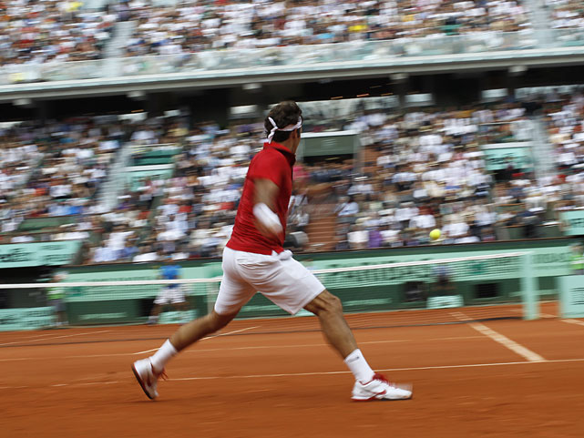 Roger Federer hits a return to Rafael Nadal.