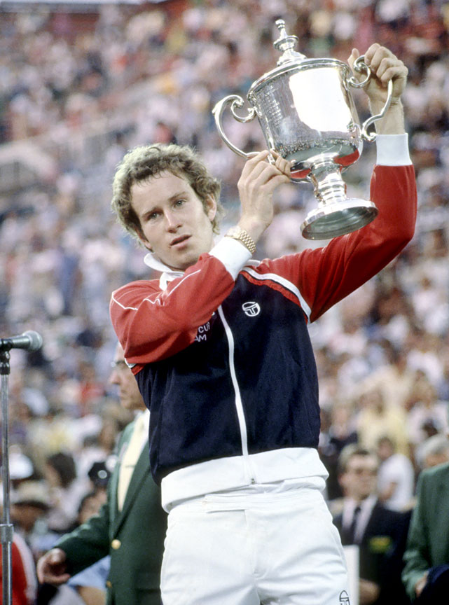 McEnroe lifts the trophy after winning the 1981 U.S. Open.