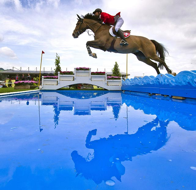 Carlina and jockey Pius Schwizer leap over a pristine pool during the FEI Nations Cup in St. Gallen, Switzerland on June 3.