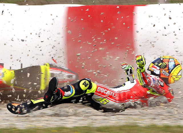 Ducati MotoGP rider Valentino Rossi crashes during a practice round of the Catalunya MotoGP Grand Prix in Montmelo, near Barcelona, Spain.