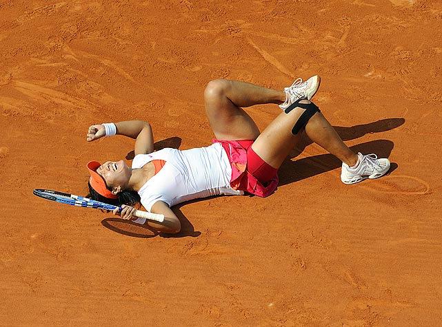 China's Li Na celebrates winning the women's final at the French Open after defeating Italy's Francesca Schiavone 6-4, 7-6. With the victory, Li became the first Chinese player to win a Grand Slam singles title.