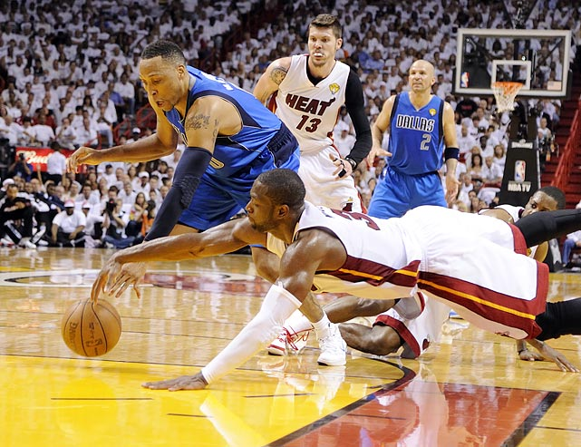 Heat guard Dwyane Wade dives for a ball during the Heat's 95-93 loss to the Mavericks in Game 2 of the NBA finals. Wade would finish the game with 36 points, but it wasn't enough to outlast the Mavericks, who closed the game on a 22-5 run.
