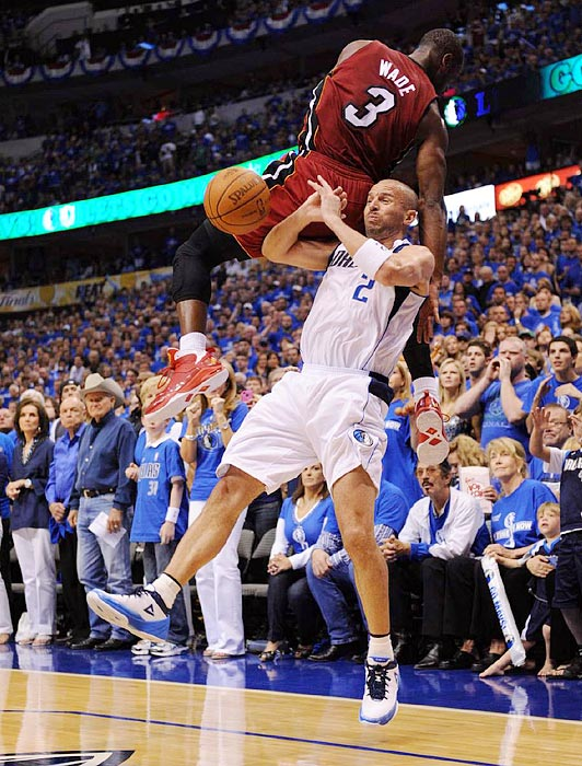 Mavericks guard Jason Kidd sends Heat guard Dwyane Wade airborne with a pump fake during the Heat's 88-86 win over the Mavericks in Game 3 of the NBA finals.