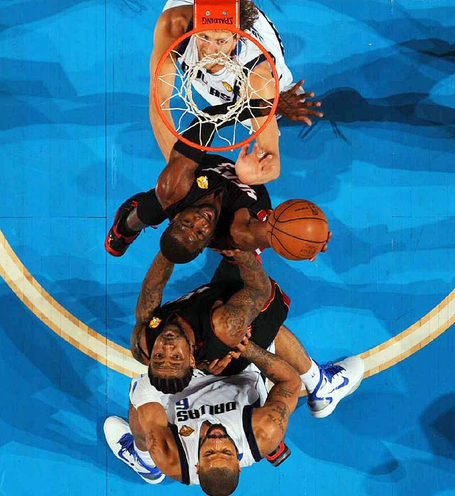 Sports Illustrated  photographer John W. McDonough captures Dwyane Wade's struggle for a rebound from an interesting angle during the Mavericks' 112-103 victory in Game 5 of the NBA finals.