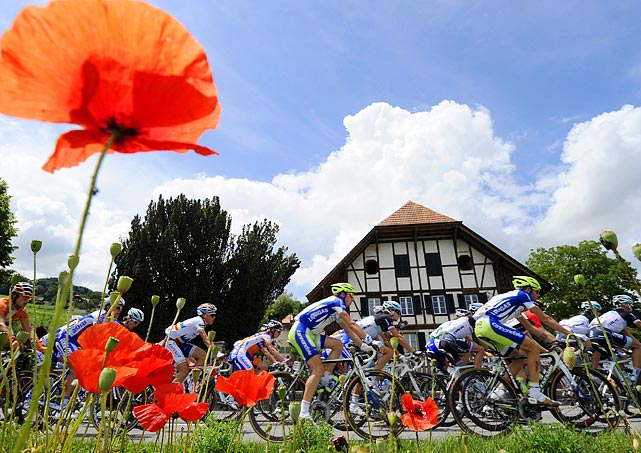 Flowers provide an idyllic foreground for the Tour of Switzerland on June 14.
