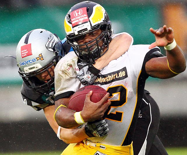 Berlin Adler's Tory Cooper (right) struggles for a few extra yards during the  European Football League's Eurobowl on June 18. The Adler fell to the Swarco Raiders Tirol 27-12.