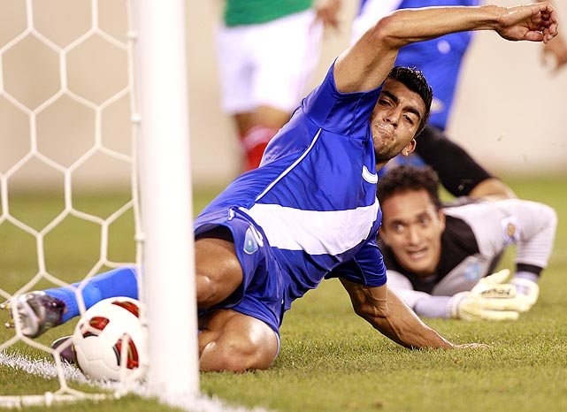 Guatemala defender Carlos Noriega (left) saves a goal after goalkeeper Paulo Cesar Motta fell to the wayside. Despite Noriega's heroic efforts, Guatemala fell to Mexico 2-1 in the CONCACAF Gold Cup quarterfinals.