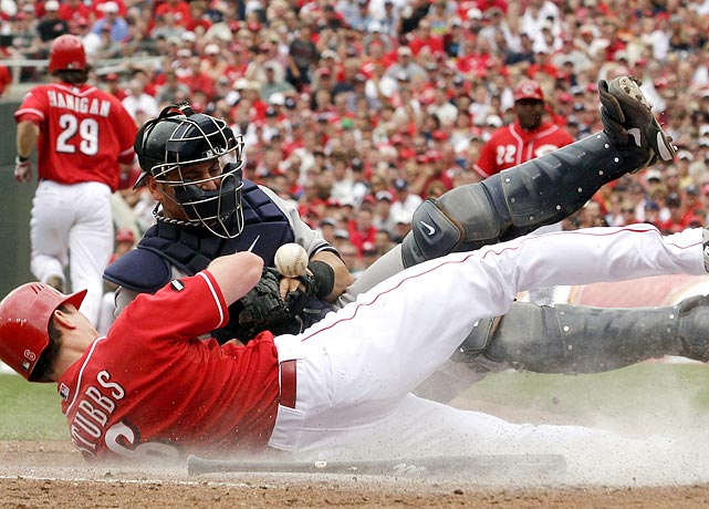 Cincinnati's Drew Stubbs jars the ball loose from New York Yankees catcher Francisco Cervelli during a 10-2 at Great American Ball Park.