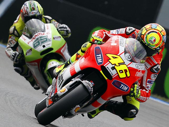 Italy's Valentino Rossi leads fellow countryman Loris Capirossi as he leans into the next curve during the qualifying practice of the MotoGP Grand Prix in Assen on June 24.