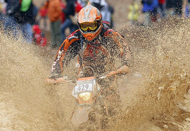 A rider conquers the mud in the 'Red Bull Hare Scramble' race during the Erzberg Rodeo in Austria on June 26. According to organizers, Red Bull Hare Scramble is the hardest Enduro race in the world.