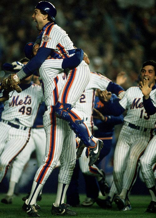 Carter is lifted into the air as the Mets celebrate their victory.