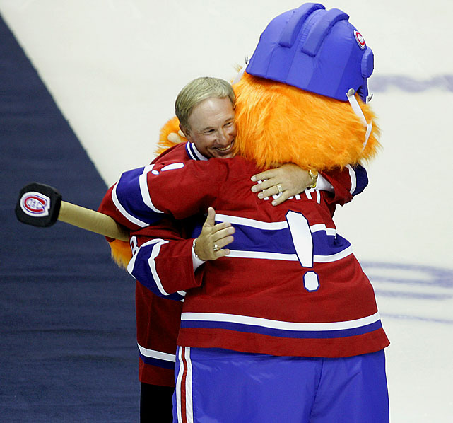 Montreal Canadiens mascot Youppi greets Carter during a pre-game ceremony.  Andre Dawson was also in attendance as the Canadiens honored greats of the now defunct Expos with a banner featuring the franchise's four retired numbers, including Carter's No. 8.