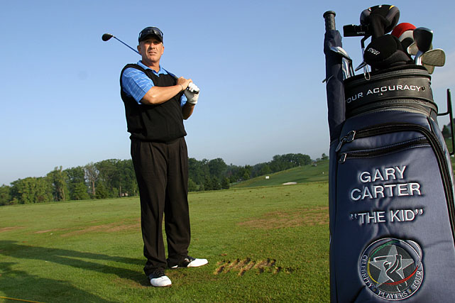 """The Kid"" holds a club during the Mellon Mario Lemieux Celebrity Invitational golf tournament."