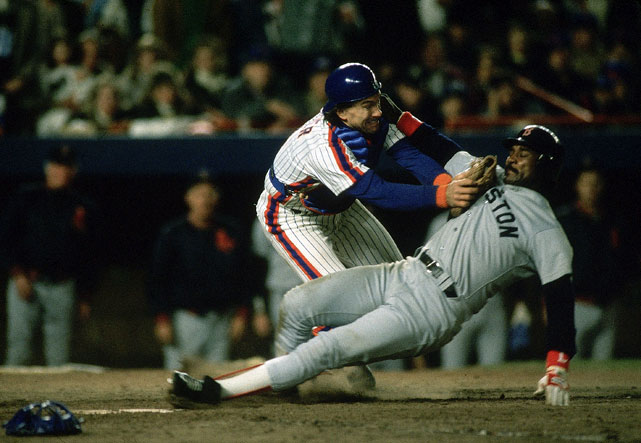 The catcher tags out Rice at home plate during Game 6 of the World Series. The Mets won the game 6-5 in 10 innings to force Game 7.