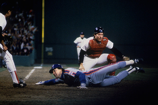 Carter reaches for home plate and looks to the umpire for a call after Gedman tried to tag him out during the 1986 World Series.