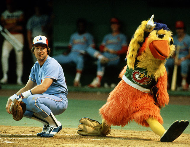 The Padres' mascot pretends to be an umpire calling a strike as Carter looks on at the second of his 11 career All-Star game appearances.