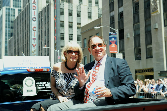 The couple sits in the back of a truck during the All-Star game parade down 6th Avenue in New York.