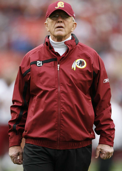 Gibbs was the head coach of the Redskins from 1981 to '92, bringing Washington its last three Super Bowl titles. Gibbs retired and was lured into other ventures, most notably NASCAR. In 2004,  Redskins owner Dan Snyder gave 64-year-old Gibbs a five-year $28.5 million contract to return to the beltway. In four years, the 'Skins made the playoffs twice, before Gibbs retired again.
