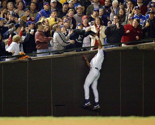 On Oct, 14, 2003, the Chicago Cubs were leading the Florida Marlins 3-0 and were five outs away from their first World Series appearance since 1945. With Luis Castillo at the plate, Steve Bartman, a Cubs fan sitting along the left field line of Wrigley Field, interfered with -- and some say prevented -- Cubs outfielder Moises Alou from catching a foul ball. Castillo went on to walk and the Marlins would score eight runs in the inning to win 8-3. The next night, the Cubs lost Game 7 and were eliminated from the NLCS. In the aftermath, Bartman received death threats and had police officers stationed outside his house.