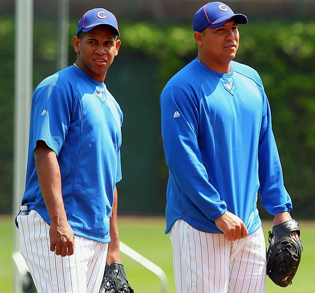 """The Cubs demonstrative ace melted down after Chicago closer Carlos Marmol (left) blew his second chance for a win in as many starts. After the game Carlos Zambrano compared the Cubs to a """"Triple-A team,"""" took Marmol to task for his pitch selection and finished with, """"we stink."""""""