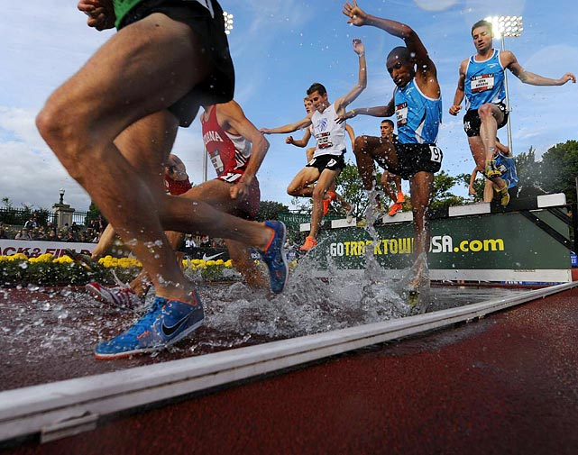 Steeplechase competitors stomped through the water jump on Thursday evening in Eugene.