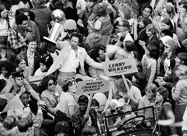 Seattle Supersonics Coach Lenny Wilkens holds up the NBA World Championship trophy before some of the thousands of fans that lined in Seattle streets on Monday, June 4, 1979 in celebration of the Sonics victory over the Washington Bullets. Seattle welcomed their heros with a noon-time parade. (AP Photo)