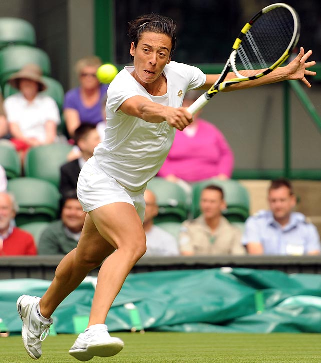 Francesca Schiavone extends for a return during her first-round match with Jelena Dokic.