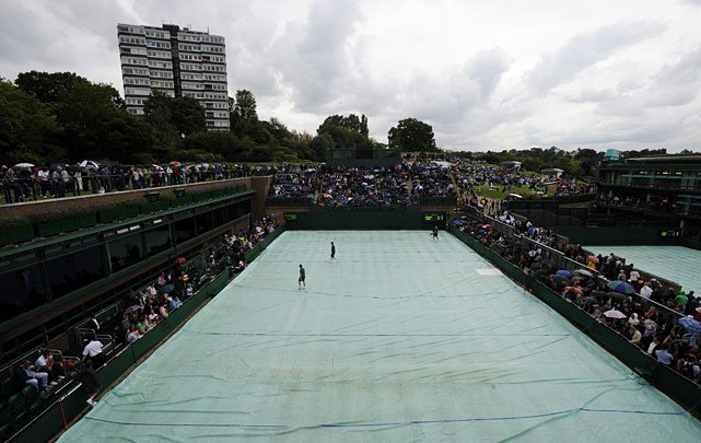 The covers are pulled onto court 14 as rain begins to fall.