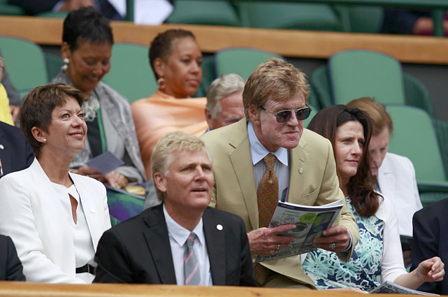 Actor Robert Redford (center) sits on Centre Court for the semifinal match between Victoria Azarenka and Petra Kvitova.