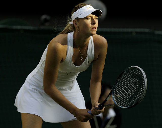 Russia's Maria Sharapova awaits a serve from compatriot Anna Chakvetadze during their first-round match.