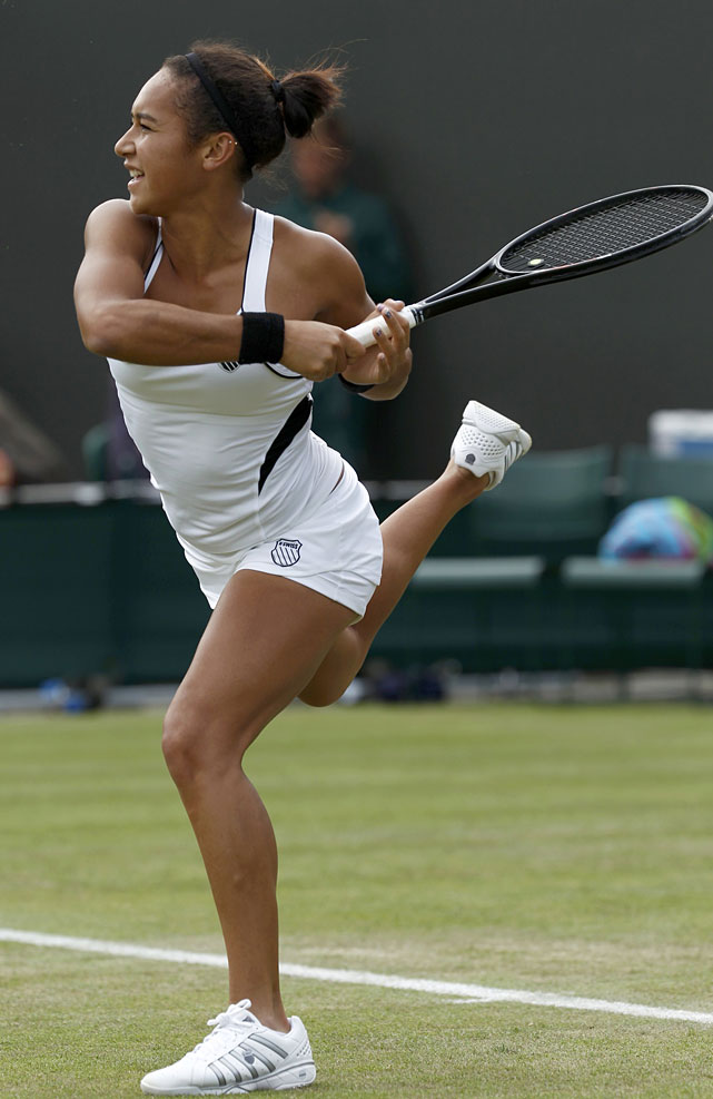 Great Britain's Heather Watson hits a return to Mathilde Johansson of France.