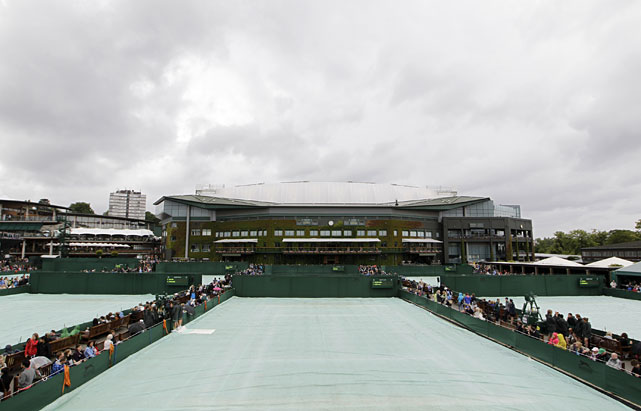 The tarps are pulled onto the courts as rain stops play at Wimbledon.