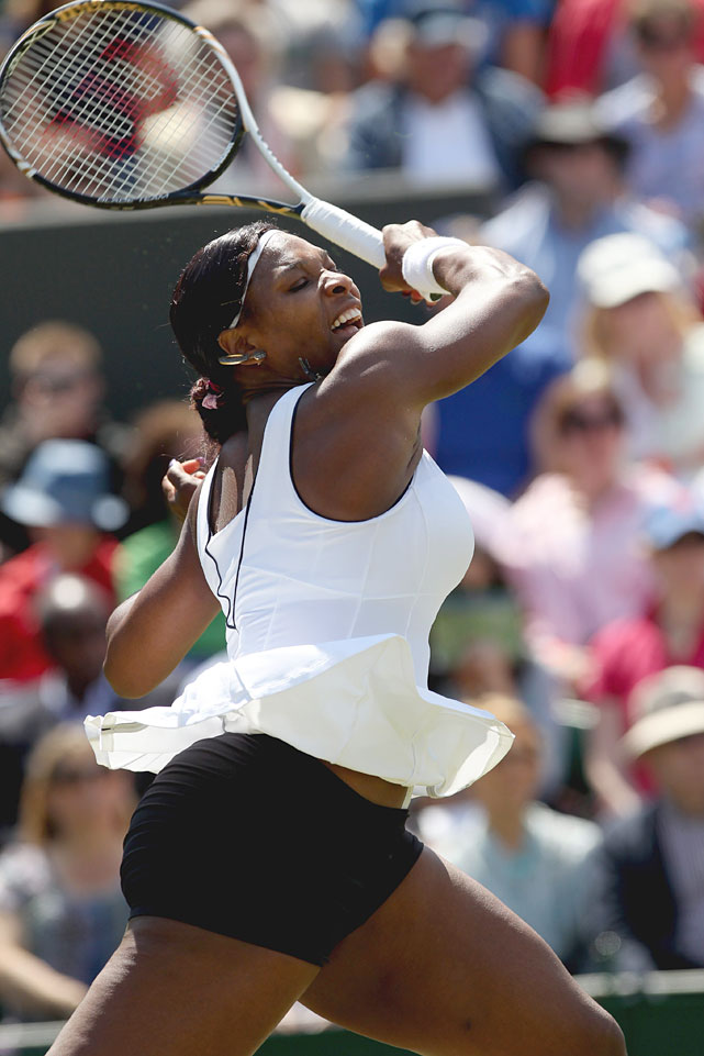 Serena Williams returns to Simona Halep during Thursday's match.