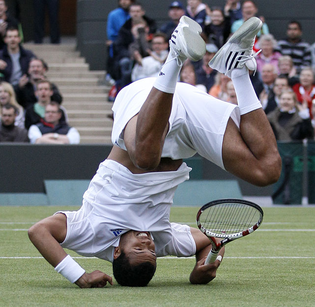 France's Jo-Wilfried Tsonga falls to the ground during his second-round match against Bulgaria's Grigor Dimitrov.