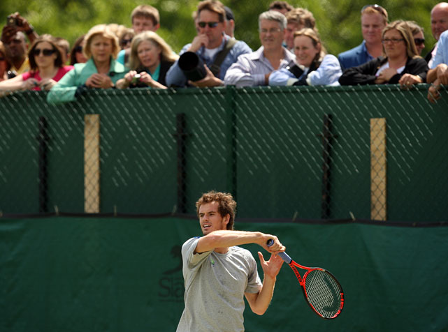 Fans wacth Great Britain's Andy Murray warming up on the practice courts.