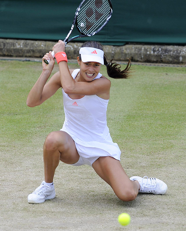 Former French Open champion Ana Ivanovic hits a backhand from her knees during a 6-2, 7-6 loss to Petra Cetkovska.