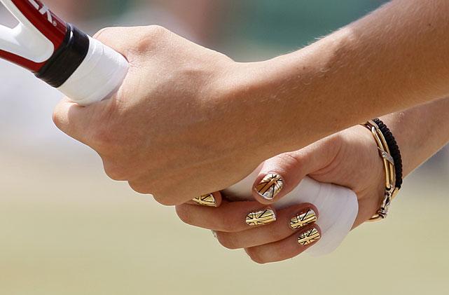 Denmark's Caroline Wozniacki holds her racquet during her fourth-round match against Slovakia's Dominika Cibulkova.