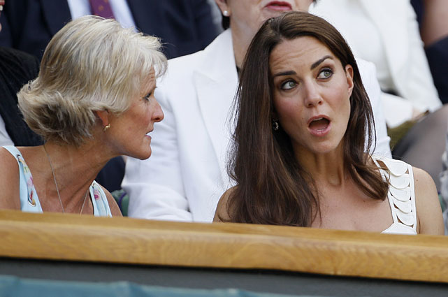 Britain's Duchess of Cambridge talks with Gill Brook, wife of All England Lawn Tennis Club chairman Philip Brook.