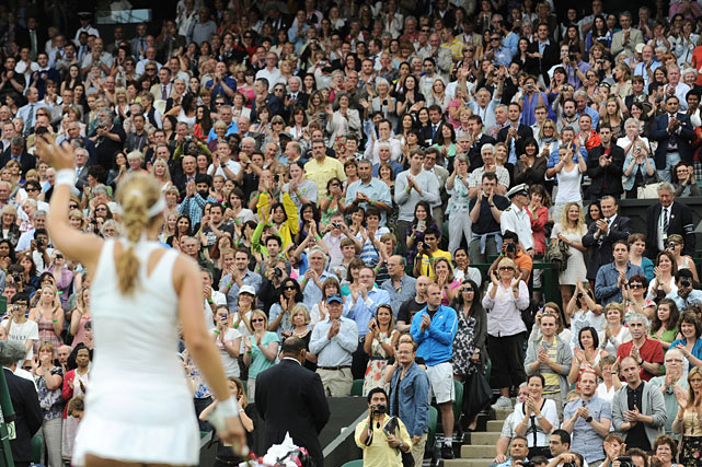 Centre Court supporters applaud Sabine Lisicki of Germany after her quarterfinal win over France's Marion Bartoli.