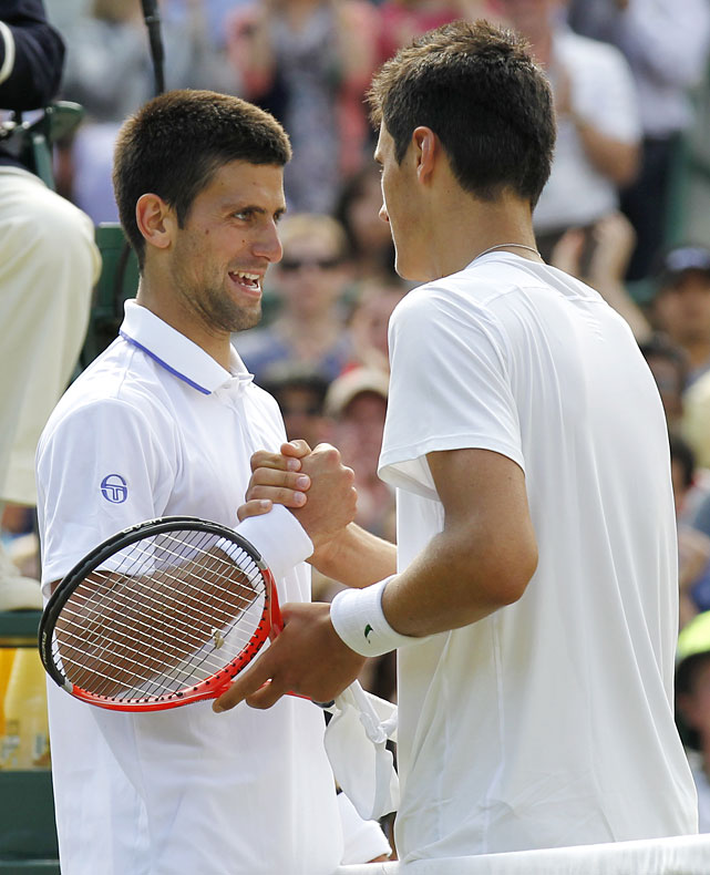 Novak Djokovic (left) shakes hands after defeating Bernard Tomic.