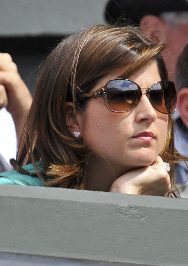 Mirka Federer observes Wednesday's Tsonga-Federer match on Centre Court.